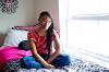 Asia Richardson in her dorm room.