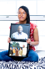 Asia Richardson with family photos.