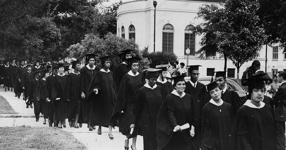 The procession of Dillard University graduates to the school's chapel. Graduating students traditionally proceed down the school's Avenue of the Oaks.